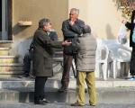 men talking in front of bar, Tuscania Italy